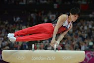 Japan&#39;s gymnast Kohei Uchimura competes on the pommel horse during the men&#39;s team final of the artistic gymnastics event of the London Olympic Games at the 02 North Greenwich Arena in London