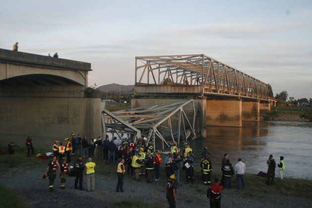 A portion of the Interstate-5 bridge is submerged after it collapsed into the Skagit river dumping vehicles and people into the water in Mount Vernon, Wash., Thursday, May 23, 2013 according to the Wa