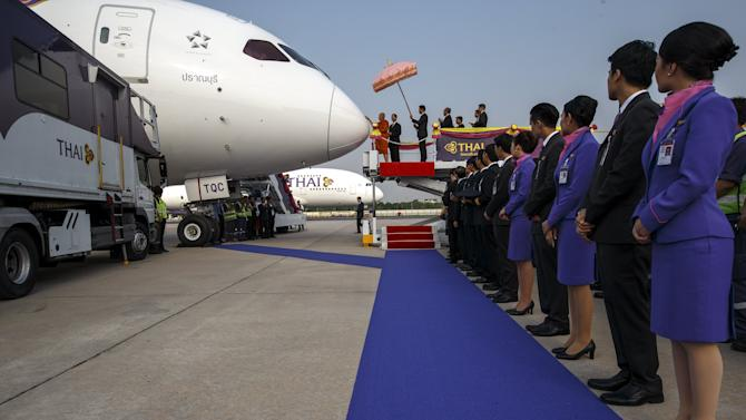 A Thai Buddhist monk blesses a Boeing B787-8 Dreamliner, bestowed with the royal name of 'Pranburi' during a Thai aircraft anointing ceremony at Bangkok's Suvarnabhumi International Airport
