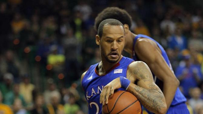 Kansas Trais Releford (24), right, grabs a loose ball over Baylor's Brady Heslip (5), left, in the first half of a NCAA basketball game, Saturday,  March 9,  2013, in Waco, Texas. (AP Photo/Waco Tribune Herald, Rod Aydelotte)