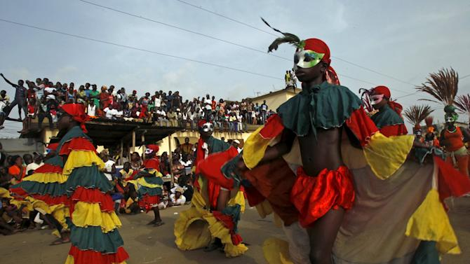 Participants take part in a parade during the Popo (Mask) Carnival of Bonoua, in the east of Abidjan