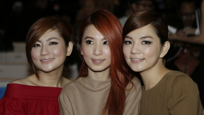 From left  , Ella Chen, Hebe Tien and Selina Jen of the Taiwanese pop group S.H.E., pose prior to the start of the the Gucci women's Spring-Summer 2013 collection that was presented in Milan, Italy, Wednesday, Sept.19, 2012. (AP Photo/Luca Bruno)