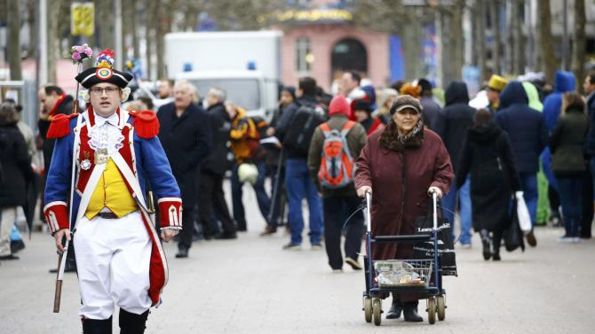 Carnival reveller strolls along street after Rosenmontag parade cancelled in Mainz