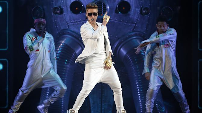 """FILE - This March 28, 2013 file photo shows Canadian singer Justin Bieber performing during the """"I Believe Tour """" in Munich, southern Germany. Billboard announced Wednesday, April 3, that Bieber, Taylor Swift, Bruno Mars and R&B singer Miguel will perform at the Billboard Music Awards on May 19 in Las Vegas(AP Photo/Matthias Schrader,File)"""