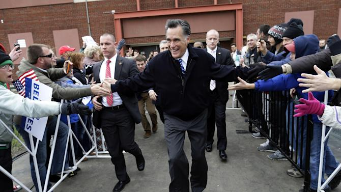 Republican presidential candidate and former Massachusetts Gov. Mitt Romney arrives to speak to an overflow crowd of supporters and as he campaigns at the Celina Fieldhouse in Celina, Ohio, Ohio, Sunday, Oct. 28, 2012. (AP Photo/Charles Dharapak)