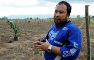 Joey Peneza talks to AFP in his farm in Datu Abdullah Sangki in southern Philippines on October 11. Peneza plants palm trees on his farm in the southern Philippines with fresh optimism, buoyed by a peace pact he hopes will finally see the violence-plagued region prosper
