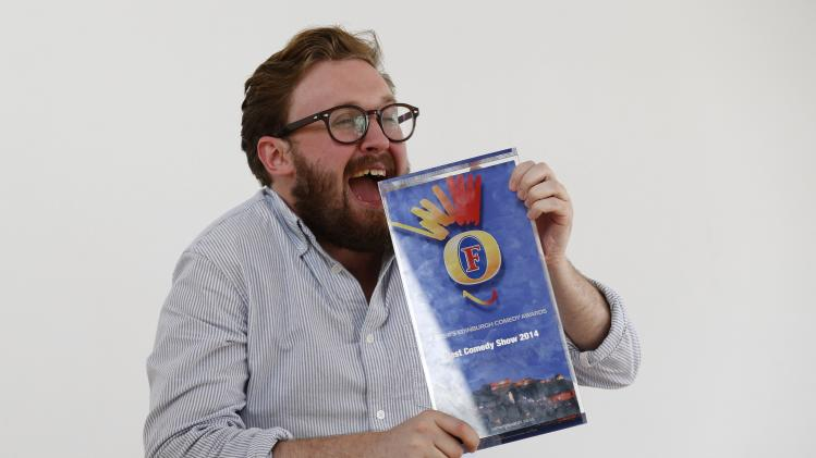 Kearns poses with his trophy for the Award for Foster's Best Comedy Show at the 34th Edinburgh Comedy Awards