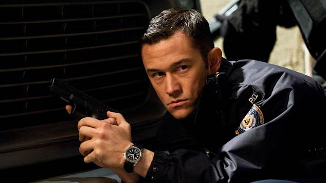 """In this publicity photo provided by Warner Bros. Pictures, Joseph Gordon-Levitt, as John Blake, is shown in a scene in Warner Bros. Pictures' and Legendary Pictures' action thriller """"The Dark Knight Rises,""""  a Warner Bros. Pictures release. TM & © DC Comics. (AP Photo/Warner Bros. Pictures, Ron Phillips)"""