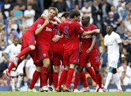 West Bromwich Albion's defender Gareth McAuley (2nd L) celebrates the goal scored by James Morrison during their English Premier League football match against Tottenham Hotspur at White Hart Lane in north London. The match ended in a 1-1 draw