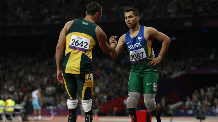 Brazil's Oliveira is congratulated by South Africa's Pistorius after winning the men's 200m T44 classification at the Olympic Stadium during the London 2012 Paralympic Games
