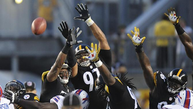 Pittsburgh Steelers defensive end Cameron Heyward (97) and the Steelers field goal defense leap to block a field goal by Buffalo Bills kicker Dustin Hopkins in the first quarter of an NFL football preseason game on Saturday, Aug. 16, 2014 in Pittsburgh. The kick was good. (AP Photo/Don Wright)