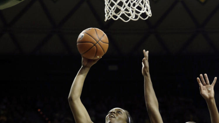 Baylor's Brooklyn Pope (32) shoots against Oklahoma's Aaryn Ellenberg (3) during the first half of an NCAA college basketball game Saturday, Jan. 26, 2013, in Waco Texas. (AP Photo/LM Otero)