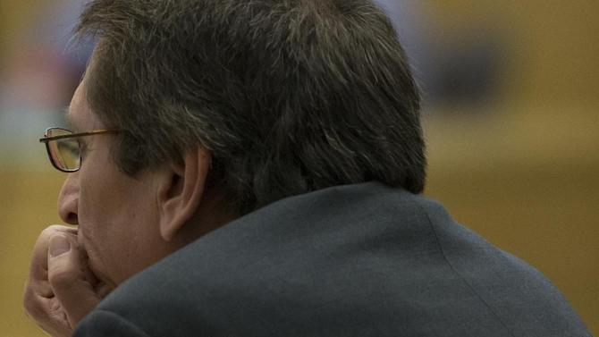Prosecutor Juan Martinez listens during the Jodi Arias trial at Maricopa County Superior Court in Phoenix on Thursday, April 18, 2013. Arias faces a potential death sentence if convicted of first-degree murder in Travis Alexander's June 2008 killing at his suburban Phoenix home. (AP Photo/The Arizona Republic, Mark Henle, Pool)