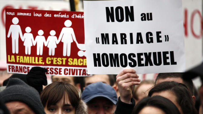 "Members of the fundamentalist Catholic group Civitas demonstrate with a poster reading ""No to Gay marraige"" in Paris, Sunday, Jan. 13, 2013. Many thousands of protesters are mobilizing against the French president's plan to legalize gay marriage, streaming into Paris by bus, car and specially reserved high-speed train. Police are expecting about 300,000 people to march toward the Eiffel Tower from three different points in the city, tying up traffic and closing subway stations for hours in what could be the largest demonstration in a decade. (AP Photo/Michel Spingler)"