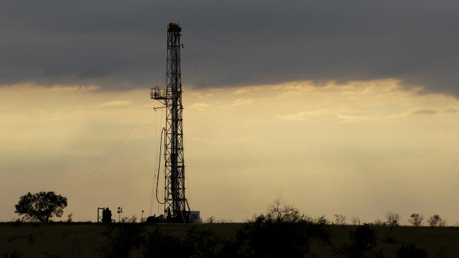 FILE - This Wednesday, May 9, 2012, file photo, shows a drilling rig near Kennedy, Texas. U.S. oil output is surging so fast that the United States could soon overtake Saudi Arabia as the world's biggest producer.  U.S. production of oil and other liquid hydrocarbons is on track to rise 7 percent in 2012 to an average of 10.9 million barrels per day. It's the fourth straight year of crude increases, and this year drillers are on track to post the biggest single year gain since 1951. (AP Photo/Eric Gay, File)