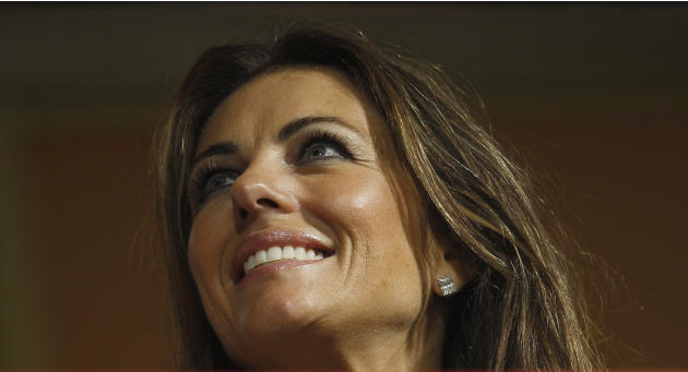 English actress  Elizabeth Hurley reportedly girlfriend of Rajasthan Royals captain Shane Warne  watches as rain delays the play of an Indian Premier League (IPL) cricket match between Royal Challenge