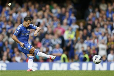 Chelsea's Eden Hazard scores with a penalty against Newcastle United during their Premier League match at Stamford Bridge in London