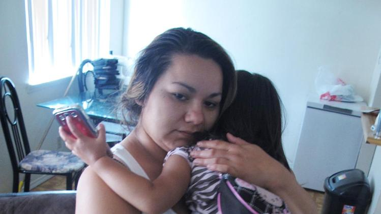 "Melissa Torrez, 27, holds her 4-year-old daughter in her apartment in Albuquerque, N.M., Friday, May 17, 2013. Torrez chased down a man for miles and ran into his car Wednesday, May 15, after he abducted her daughter. She told The Associated Press her ""mother's instincts"" kicked in when she launched her chase.  Police later arrested 31-year-old David Hernandez and charged him with kidnapping and child abuse. (AP Photo/Russell Contreras)"