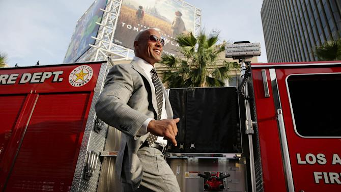 "Dwayne Johnson seen at New Line Cinema presents the Los Angeles World Premiere of ""San Andreas"" at TCL Chinese Theatre on Tuesday, May 26, 2015, in Hollywood, CA. (Photo by Eric Charbonneau/Invision for Warner Bros./AP Images)"