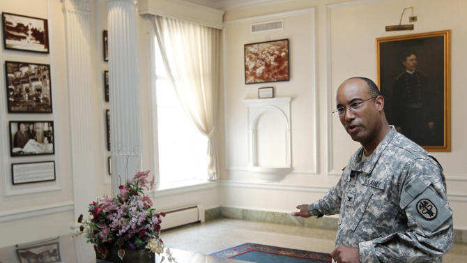 U.S. Army Col. Norvell V. Coots gestures during an interview in the main lobby of the Walter Reed Army Medical Center in Washington, Thursday, July 21, 2001.  Walter Reed Army Medical Center, the military's flagship hospital where privates to presidents have gone for care for more than a century, is closing its doors. Hundreds of thousands of the nation's war wounded from World War I to today have received treatment at Walter Reed, including 18,000 troops who served in Iraq and Afghanistan. (AP Photo/Luis M. Alvarez)