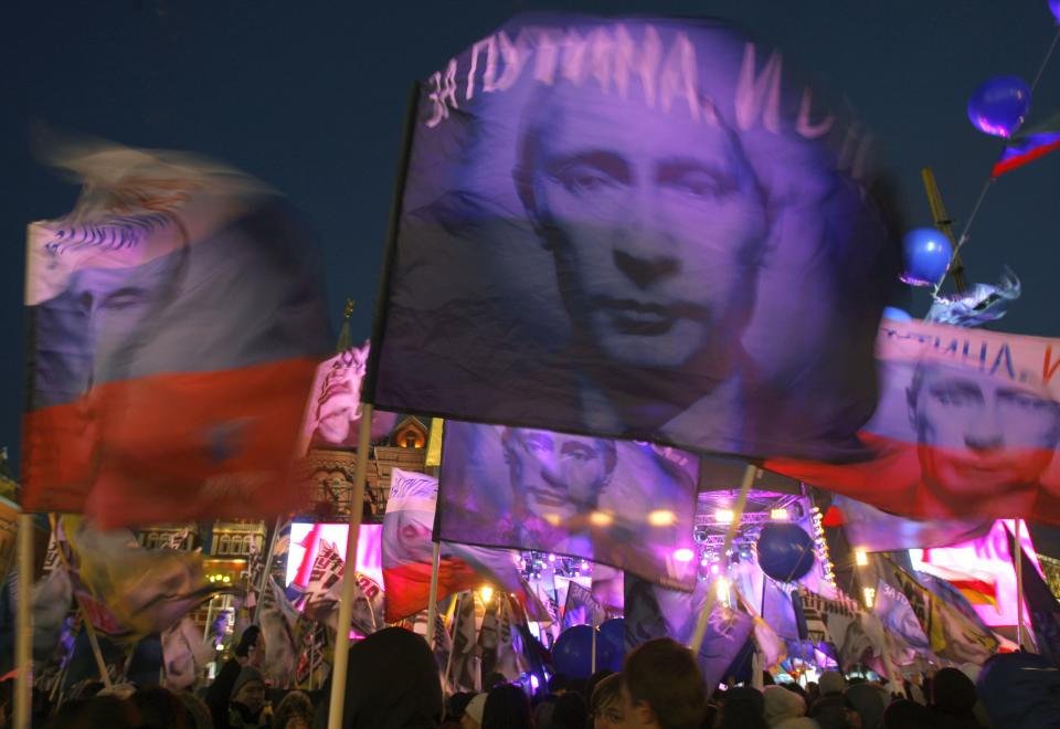 Supporters of Russian Prime Minister and presidential candidate Vladimir Putin rally at the central Manezhnaya Square just outside the Kremlin as they celebrate his victory in Moscow, Russia, Monday, March 5, 2012. (AP Photo/Sergei Grits)