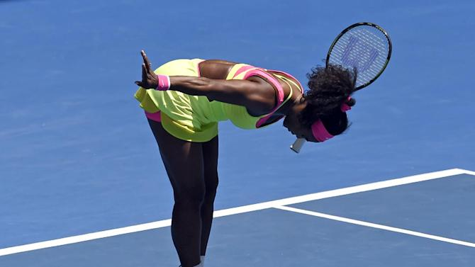 Serena Williams of the U.S. reacts as she plays Dominika Cibulkova of Slovakia during their quarterfinal match at the Australian Open tennis championship in Melbourne, Australia, Wednesday, Jan. 28, 2015. (AP Photo/Andy Brownbill)
