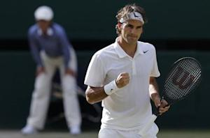 Roger Federer of Switzerland reacts during his men's singles semi-final tennis match against Milos Raonic of Canada at the Wimbledon Tennis Championships, in London