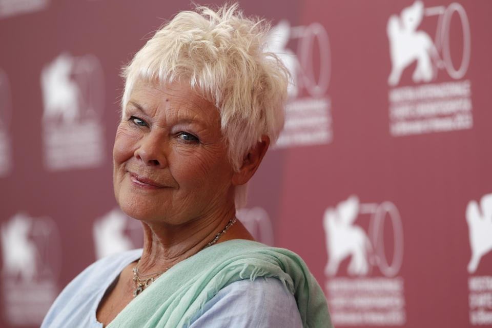 Actor Judi Dench poses for photographers during a photo call to promote the film Philomena at the 70th edition of the Venice Film Festival held from Aug. 28 through Sept. 7, in Venice, Italy, Saturday, Aug. 31, 2013. (AP Photo/David Azia)