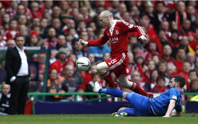 Inverness Caledonian Thistle's Graeme Shinnie challenges Aberdeen's Willo Flood during their Scottish League Cup final soccer match in Scotland