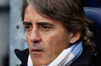 Mancini declares Manchester City title hopes 'impossible'
