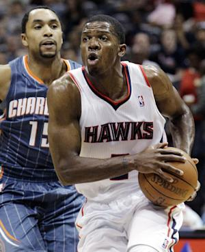 FILE - In this April 4, 2012, file photo, Atlanta Hawks' Joe Johnson, right, drives against Charlotte Bobcats' Gerald Henderson,in an NBA basketball game in Atlanta. Multiple media outlets, starting with ESPN and all citing anonymous sources, are reporting the Hawks and New Jersey Nets have agreed to a trade that would send Johnson from Atlanta to Brooklyn, Monday, July 2. (AP Photo/David Goldman, File)
