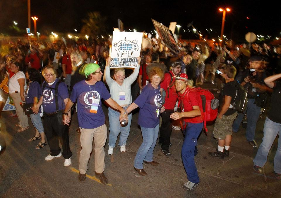 "Demonstrators gather outside a Maricopa County Sheriff's Office jail, called ""Tent City"", Saturday, June 23, 2012, in Phoenix. Critics of Maricopa County Sheriff Joe Arpaio gathered Saturday night for a rally to call for the closure of the sheriff's complex of canvas jail tents. (AP Photo/Matt York)"