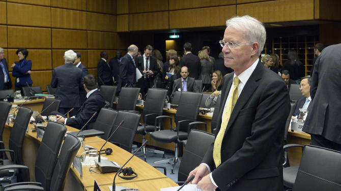Joseph E. Macmanus, permanent U.S. Representative to the United Nations waits for the start of the IAEA board of governors meeting at the International Center in Vienna, Austria, Monday, June 3, 2013. The chief of the U.N. nuclear agency is urging Iran to cooperate with a probe of his agency, in unusually frank language showing exasperation with the stalled investigation. Yukiya Amano of the International Atomic Energy Agency says negotiations with Iran to restart the probe ''have been going around in circles.'' He says he is addressing his appeal ''with a sense of urgency.''Amano spoke Monday at the start of a 35-nation board meeting of his International Atomic Energy Agency. His comments were focused on Parchin, a site southeast of Tehran where the IAEA suspects Iran worked on nuclear arms. (AP Photo/Hans Punz)