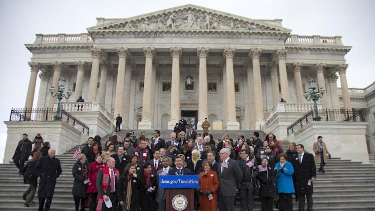 Rep. Xavier Becerra, D-Calif., center, surrounded by fellow House Democrats and immigration leaders, speaks on the steps of the Capitol in Washington, Wednesday, March 26, 2014, during a new conference to announce a DemandAVote discharge petition and call on House Speaker John Boehner of Ohio, and the House Republican Conference to bring up immigration reform bill H.R. 15. Directly behind Becerra from left are Rev. Randy Mayer, Actress America Ferrera, Rep. Judy Chu, D-Calif., Rep. Steven Horsford., D-Nev., and House Minority Leader Nancy Pelosi of Calif. (AP Photo/Carolyn Kaster)