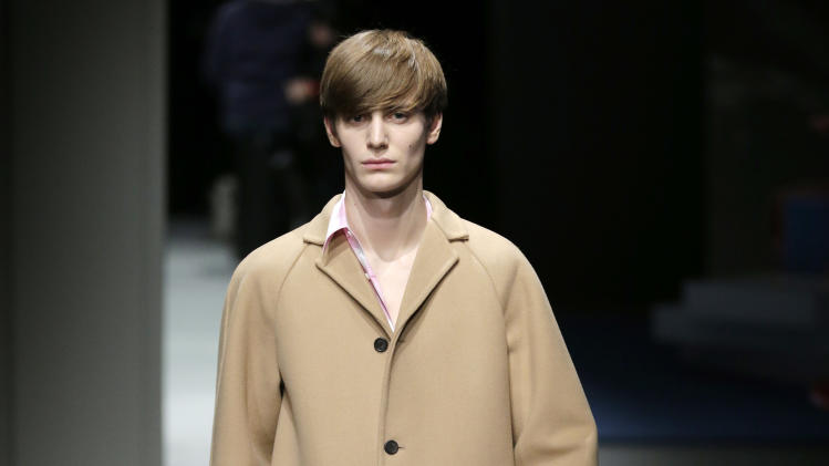 A model wears a creation for Prada men's Fall-Winter 2013-14 collection, part of the Milan Fashion Week, unveiled in Milan, Italy, Sunday, Jan. 13, 2013. (AP Photo/Antonio Calanni)