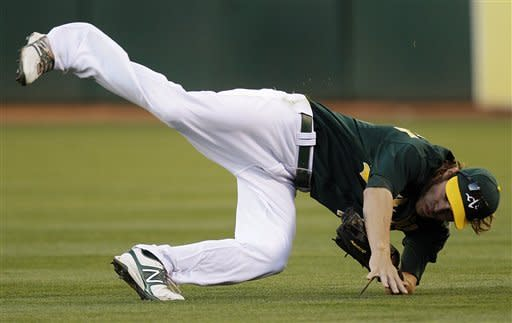 Milone, Cespedes lead A's past Dodgers 4-1