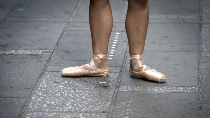 """A dancer poses during a photo shoot for the """"Dance as Art"""" photo project in Times Square in New York"""