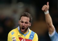Napoli's Gonzalo Higuain reacts during their Italian Serie A soccer match against Lazio at the Olympic stadium in Rome December 2, 2013. REUTERS/Tony Gentile (ITALY - Tags: SPORT SOCCER)