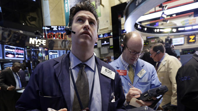 FILE - In this March 7, 2014 file photo, Glenn Kessler, left, works with fellow traders on the floor of the New York Stock Exchange. World stock markets steadied Tuesday, March 11, 2014 after a sell-off the day before. (AP Photo/Richard Drew, File)