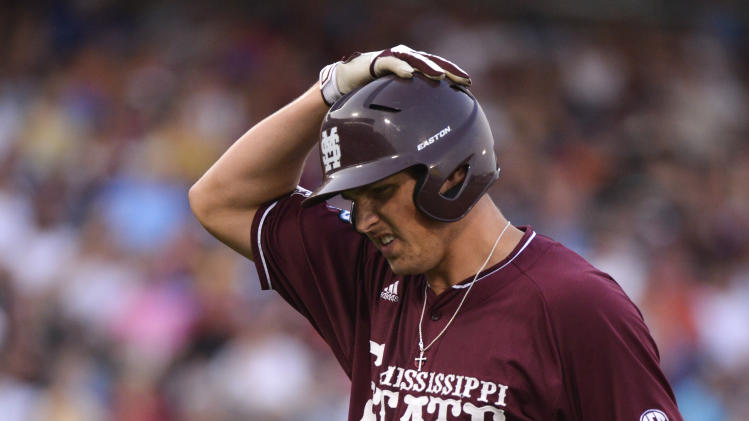 Mississippi State's Hunter Renfroe holds his head after flying out to left field against UCLA in the fourth inning of Game 2 in their NCAA College World Series baseball finals, Tuesday, June 25, 2013, in Omaha, Neb. (AP Photo/Ted Kirk)