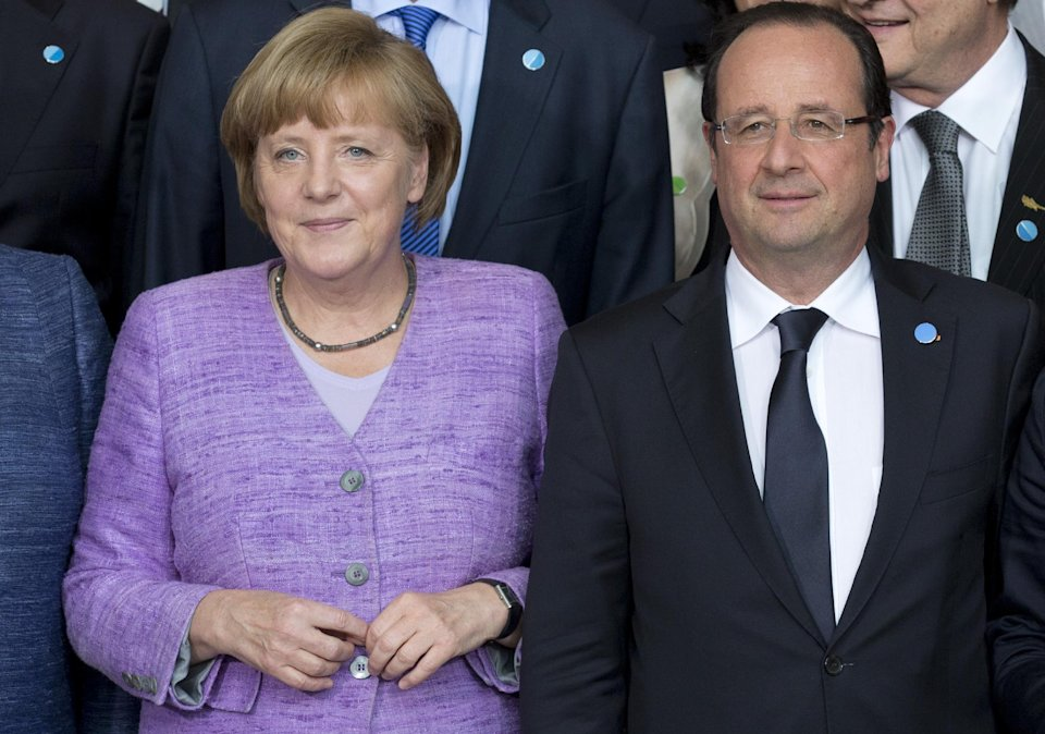 German Chancellor Angela Merkel and French President Francois Hollande pose for a group picture after the Conference on Promoting Youth Employment in Europe in Berlin, Germany, Wednesday, July 3, 2013. Merkel was bringing together officials from across Europe Wednesday to discuss how best to get young people into jobs, and is insisting that money alone won't end high youth unemployment. (AP Photo/Axel Schmidt)
