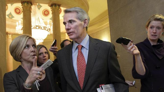 """FILE - This Nov. 15, 2011 file photo shows Sen. Rob Portman, R-Ohio, a member of last year's failed Joint Select Committee on Deficit Reduction, pursued by reporters on Capitol Hill in Washington. Sure, the rich are going to pay higher taxes. But an upcoming budget deal may also mean higher airline ticket prices, phasing out Saturday mail delivery and added prescription drug costs for the military. Negotiators are also looking to claim cuts to farm subsidies and modest curbs to food stamps as they seek to accumulate savings toward a multi-trillion-dollar budget pact. """"All this stuff is hard. There's nothing easy here,"""" says Portman, R-Ohio, which sifted through a long roster of often arcane budget cuts and new fees. """"But if everybody feels like everybody else is contributing, it makes it easier.""""   (AP Photo/J. Scott Applewhite, File)"""