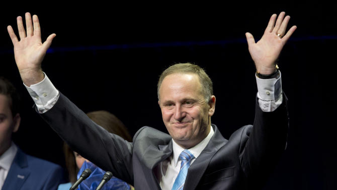 New Zealand Prime Minister John Key waves as he makes a speech after winning the national election in Auckland, New Zealand, Saturday, Sept. 20, 2014. Key won an emphatic victory in New Zealand's general election to return for a third term in office, a result that will be seen as an endorsement of the way Key's National Party has handled the economy. (AP Photo/New Zealand Herald, Mark Mitchell) NEW ZEALAND OUT, AUSTRALIA OUT