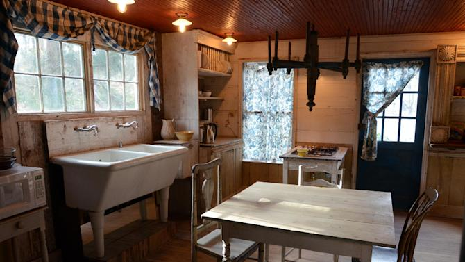 """This photo taken Feb. 1, 2012, shows the renovated kitchen inside the Decker House, one of six properties Bronson Pinchot owns in Harford, Pa.  Pinchot, best known for his starring role on the 1980's sitcom """"Perfect Strangers,"""" is back on TV with a new show about restoring his historic Pennsylvania homes. The show, """"The Bronson Pinchot Project,"""" premiered this month on the DIY cable network. (AP Photo/Heather Ainsworth)"""