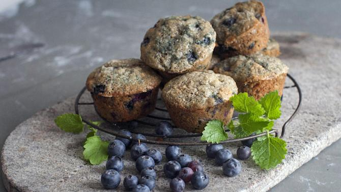This June 30, 2014 photo shows hearty blueberry banana muffins in Concord, N.H. The whole-grain, fruit-packed muffins can begin a day with a healthy start. (AP Photo/Matthew Mead)