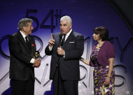 From left, Tony Bennett, Mitch Winehouse, and Janis Winehouse accept the best pop duo group performance award at the 54th annual GRAMMY Awards pre-show on Sunday, Feb. 12, 2012 in Los Angeles. (AP Photo/Matt Sayles)