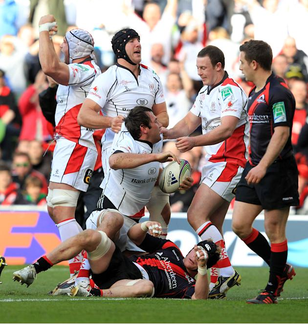 Ulster's Declan Fitzpatrick (C) celebrates with teammates after scoring a try against Edinburgh during the semi-final European Rugby match at the Aviva Stadium in Dublin, Ireland on April 28, 2012. AF