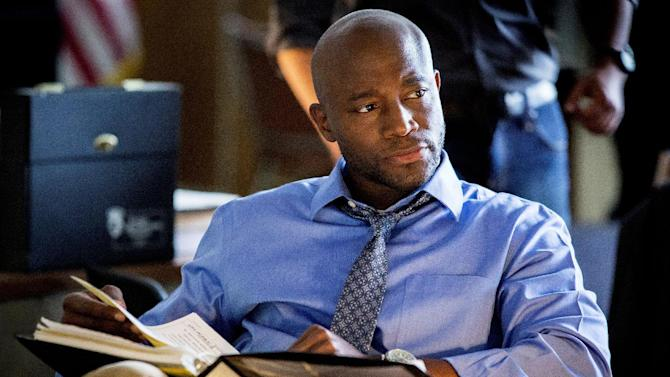 "This photo released by TNT shows Taye Diggs in a scene from the pilot for ""Murder in the First."" Diggs stars as a San Francisco police detective in the drama that also stars Kathleen Robertson and debuts Monday, June 9, 2014. (AP Photo/TNT, Trae Patton)"