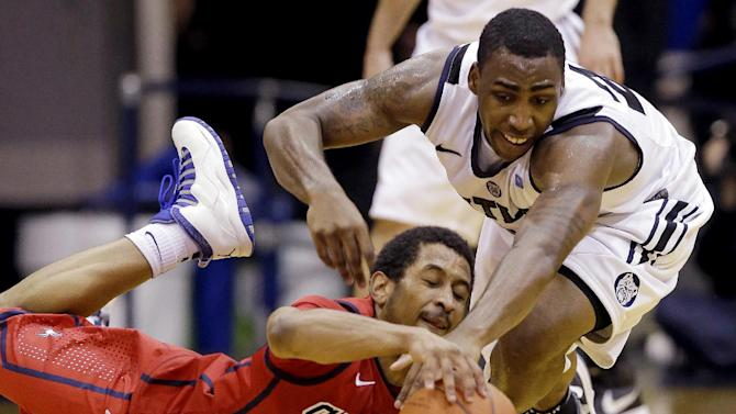 Richmond guard Cedrick Lindsay, bottom, and Butler forward Roosevelt Jones go to the court for a loose ball in the second half of an NCAA college basketball game in Indianapolis, Wednesday, Jan. 16, 2013. Butler won 62-47. (AP Photo/Michael Conroy)