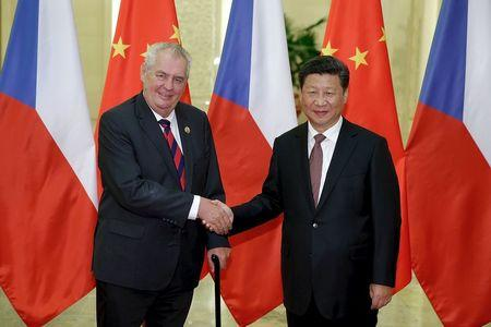 Chinese President Xi Jinping shakes hands with Czech President Milos Zeman at the Great Hall of the People in Beijing